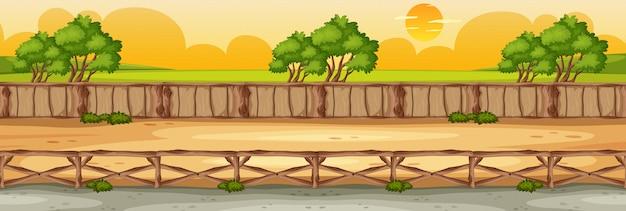 地平線の自然のシーンまたは森の景色と黄色の夕焼け空の景色と田舎の風景