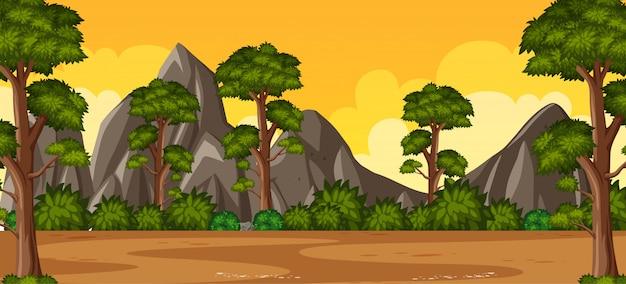 地平線の自然のシーンまたは森の景色と黄色の夕焼け空の景色の田園風景