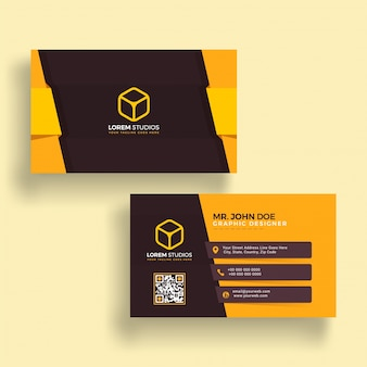 Horizontal golden and brown business card with front and back presentation.