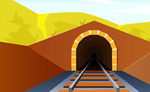 鉄道トンネルへの入り口のある水平方向の山の風景