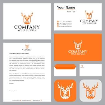 Голова рогатого оленя в щите логотип с визитной карточкой
