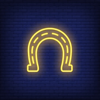 Horseshoe neon sign element. gambling concept for night bright advertisement