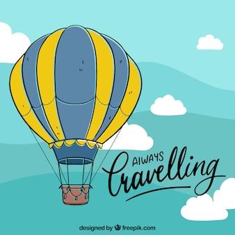 Фон с воздушным шаром с небом в ручном стиле
