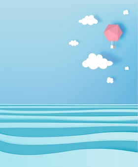Hot air balloon paper art style with pastel sky and ocean background