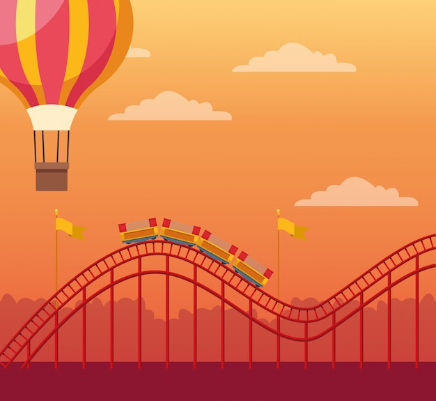 Hot air balloon and roller coaster over orange sunset