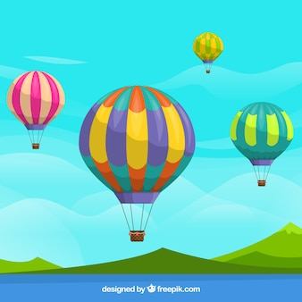 熱気球は雲の空の背景