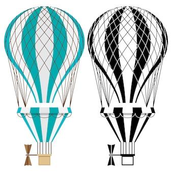 熱気球。白地にカラフルで黒と白のエアロスタット