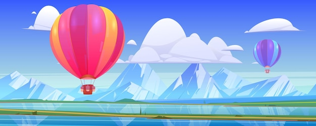 Hot air balloons fly above mountain landscape with lake and green meadows in valley.