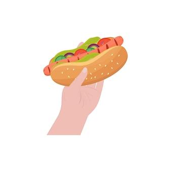 Хот-дог в руке. колбаса на гриле, овощи в пшеничной булочке. быстрое питание, доступные закуски. шаблон оформления национального дня хот-дога. векторная иллюстрация, квартира