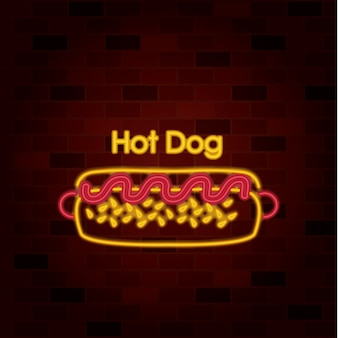 Hot dog on neon sign on brick wall
