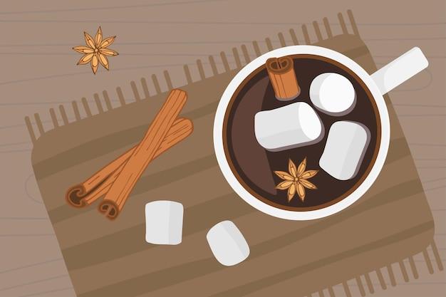 ホットドリンクカップは、ライトブラウンのナプキンの木製テーブルの上に立っていますホットチョコレートまたはコーヒー