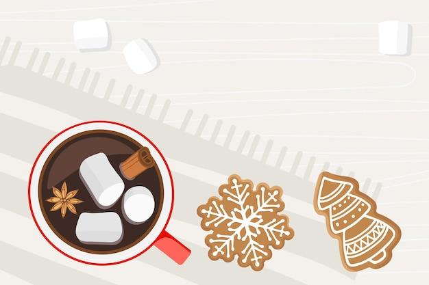ホットドリンクの赤いカップは、クリスマスのジンジャーブレッドホットチョコレートまたはコーヒーとナプキンの上に立っています