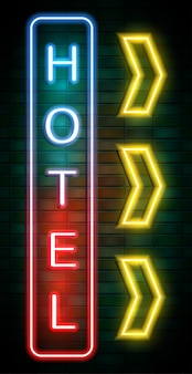 Hotel neon sign on brick wall