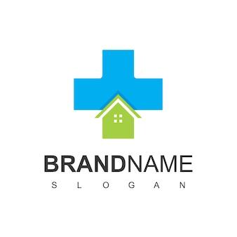 病院のロゴの家と十字架のシンボル