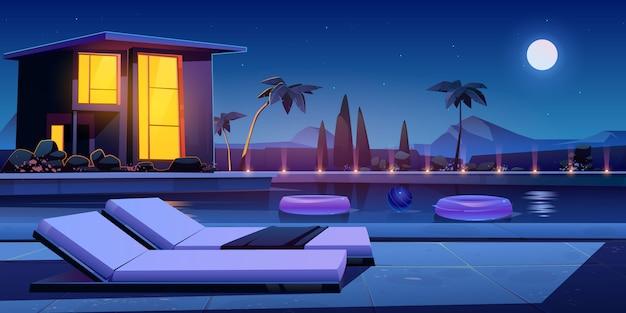 밤에 집과 수영장