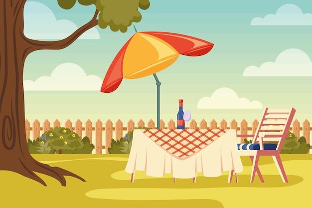 Задний двор дома со столом и зонтиком