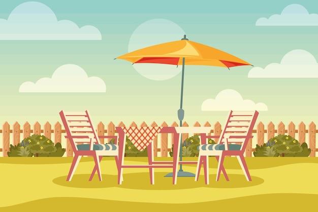 Задний двор дома с зонтиком и столом