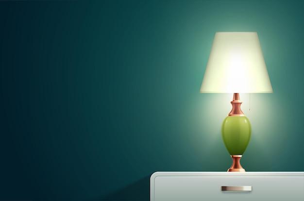 작은 디자이너 램프가 있는 단단한 파란색 벽과 침대 옆 탁자가 있는 집 조명 램프 현실적인 구성