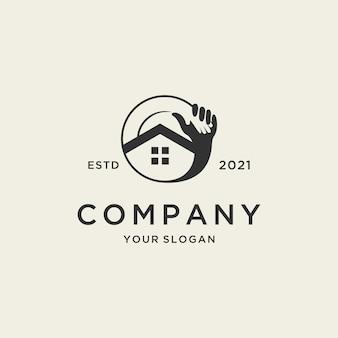 Дом логотип с круглым дизайном руки для недвижимости