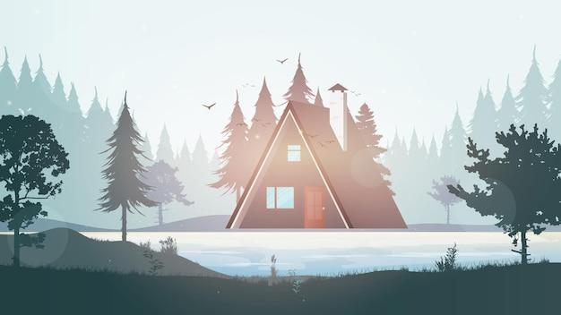 川の近くの家。美しい小屋のある湖の風景。