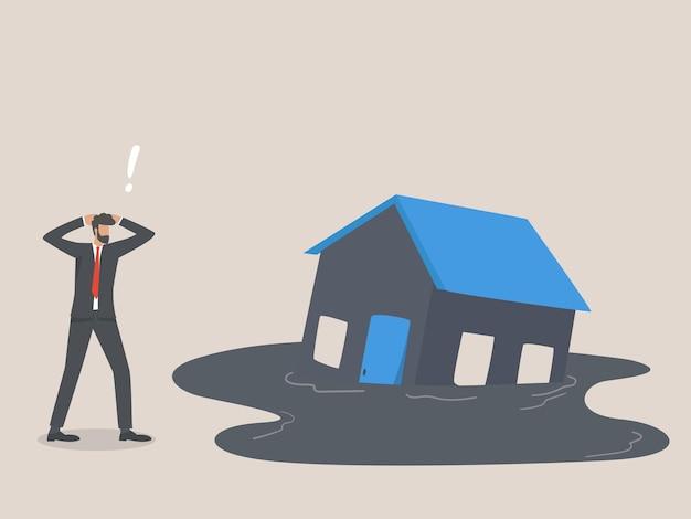 住宅の沈没、不動産市場の暴落または不況の概念。