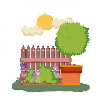 庭にフェンスを持つ花のhouseplant