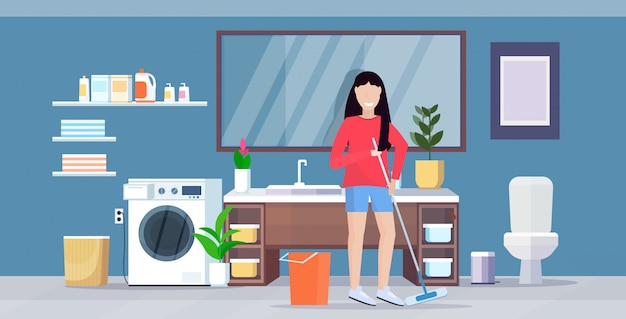 Housewife mopping floor smiling woman cleaner holding mop doing housework cleaning service housekeeping concept modern bathroom interior full length flat horizontal