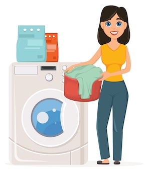 Housewife washes clothes in the washing machine
