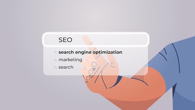 Human hand choosing seo in search bar on virtual screen search