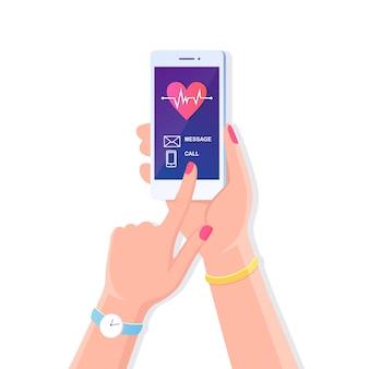 Человеческая рука держит мобильный телефон с красным сердцем, линией сердцебиения, кардиограммой на экране. вызовите врача, скорую помощь. смартфон, изолированные на белом фоне. плоский дизайн