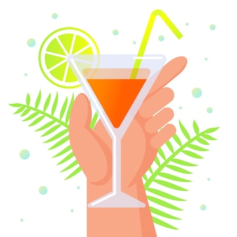 Human hand holding glass with cocktail, summertime