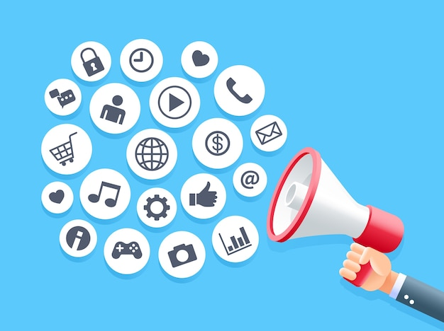 Human hand holding megaphone with bubble social media icons concept