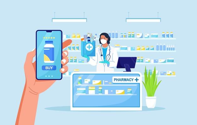 의학 온라인 지불을 위해 휴대 전화를 들고 있는 인간의 손. 택배 약국 서비스. 약사는 약병, 약, 약, 온도계가 들어 있는 종이 봉지를 들고 있습니다.