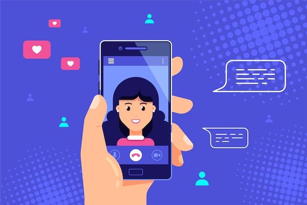 画面上の女性キャラクターとスマートフォンを持っている人間の手。ビデオ通話、オンラインビデオチャット、インターネット技術。