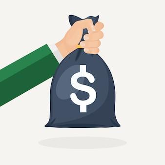 Human hand holds money bag