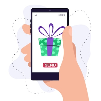 A human hand holds a smartphone to send a gift online