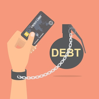 Human hand with debt bomb chained holding credit card