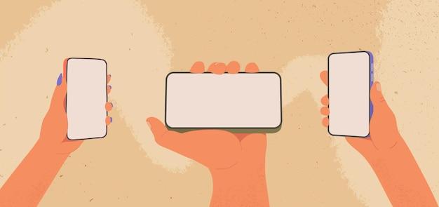 인간의 손은 스마트폰 만화 남성과 여성의 팔을 잡고 빈 디스플레이가 평평한 전화기를 들고 있습니다.