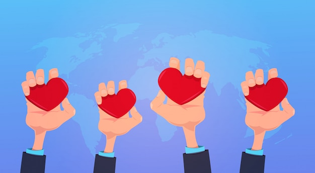Human hands holding red love heart health care concept on blue world map background flat