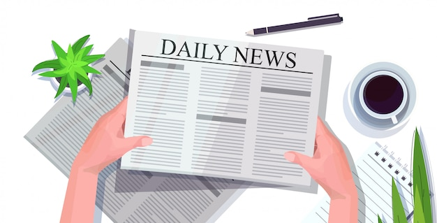 Human hands reading newspaper daily news press mass media concept workplace desk top angle view