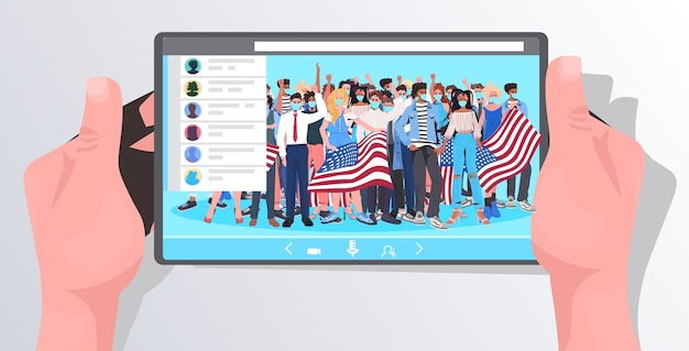 Human hands using tablet pc watching online video people in masks holding usa flags labor day celebration coronavirus quarantine concept portrait