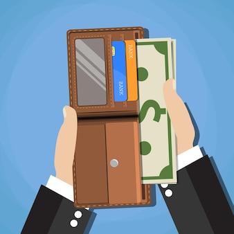 열린 지갑에 현금 달러를 넣는 인간