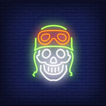 Human skull in helmet on brick background. neon style illustration. bikers club, motocross