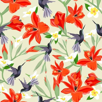 Humiingbird in orange and white blossom seamless pattern.
