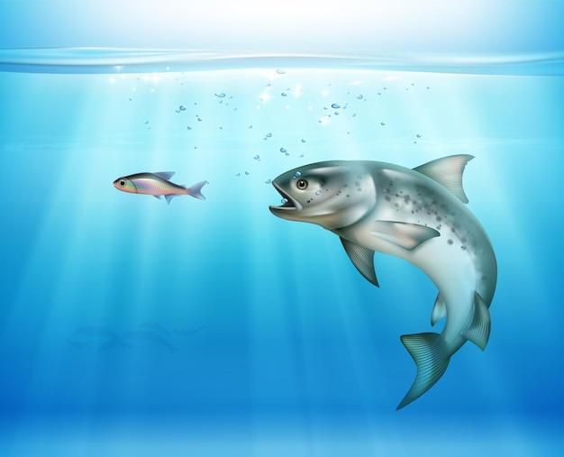 Caccia ai pesci sott'acqua illuminati da raggi di luce