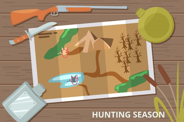 Hunting season  background with map on wood table and hunting equipment