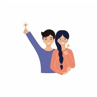 Муж и беременная жена празднуют новый год и рождество. супружеская пара держит бенгальские огни. счастливые родители встречают новый год в кругу семьи.