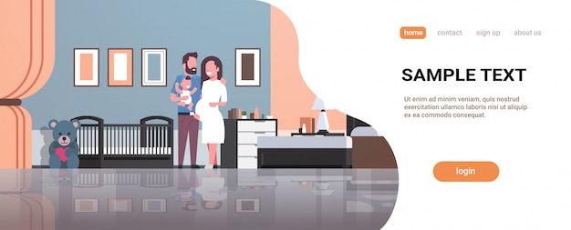 Husband with pregnant wife holding newborn baby son standing near crib landing page