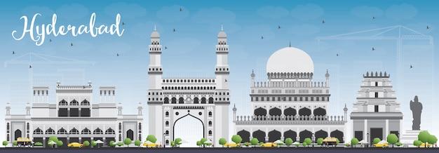Hyderabad skyline with gray landmarks and blue sky.