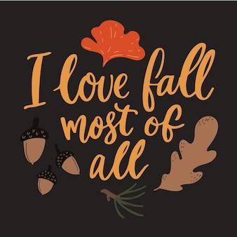 私はすべての兆候の中で秋が大好きです。秋の名言、銀杏の葉とどんぐり。手書きのタイポグラフィ。